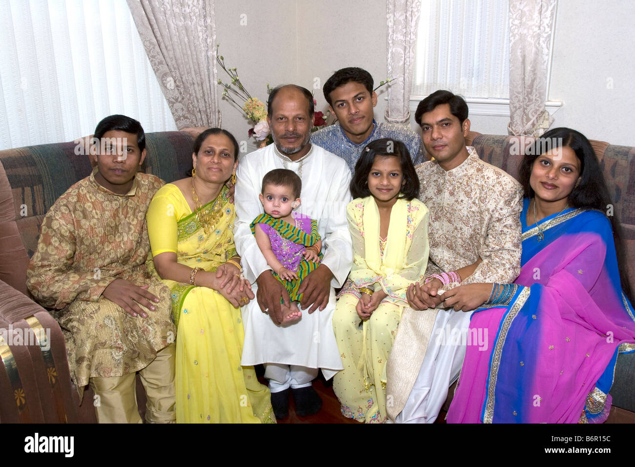 Bangladeshi American family at home in Brooklyn New York for the Muslim holiday of Eid, marking the end of Ramadan - Stock Image