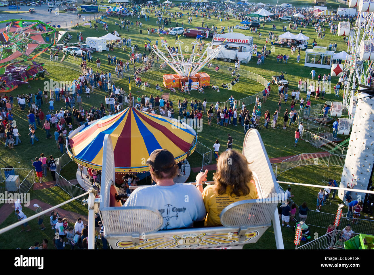 A Couple Enjoys The Ferris Wheel At A Small Carnival In Monroe Stock Photo Alamy