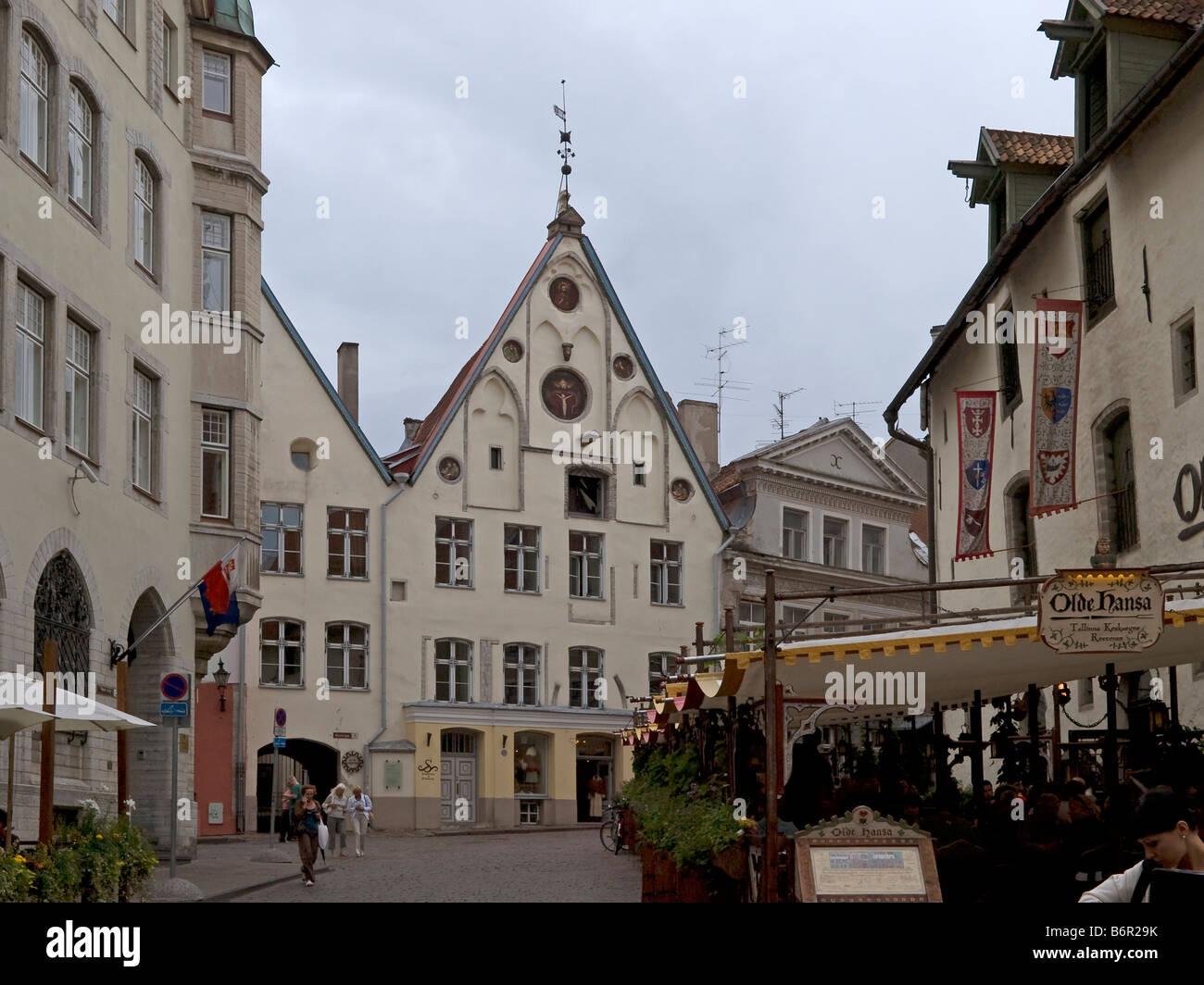street historical mediaeval houses restaurant Olde Hansa oldest restaurant of Tallinn in the old town of Tallinn - Stock Image