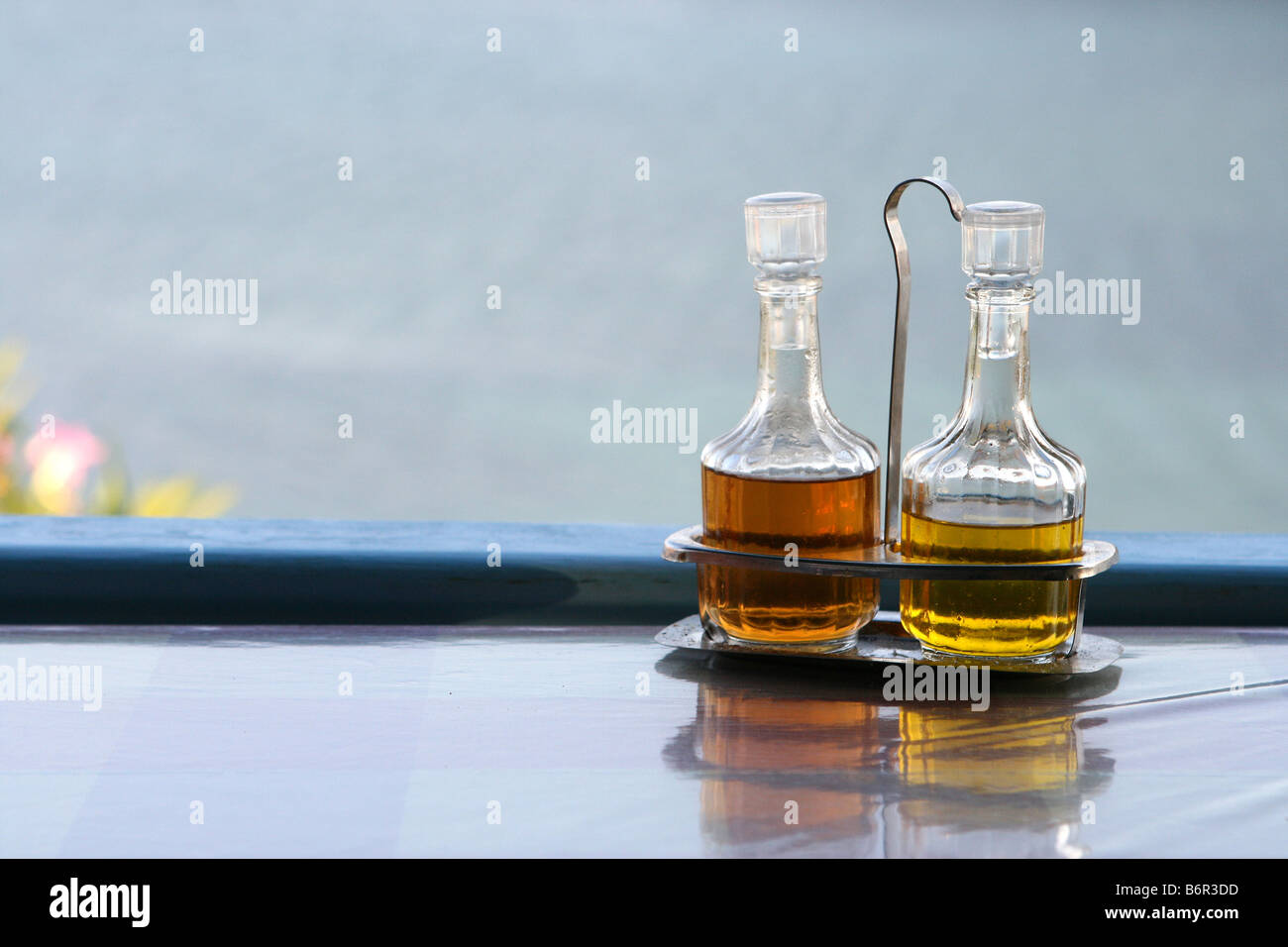 salad and food sauce bottles winegar and oil detail from restaurant - Stock Image