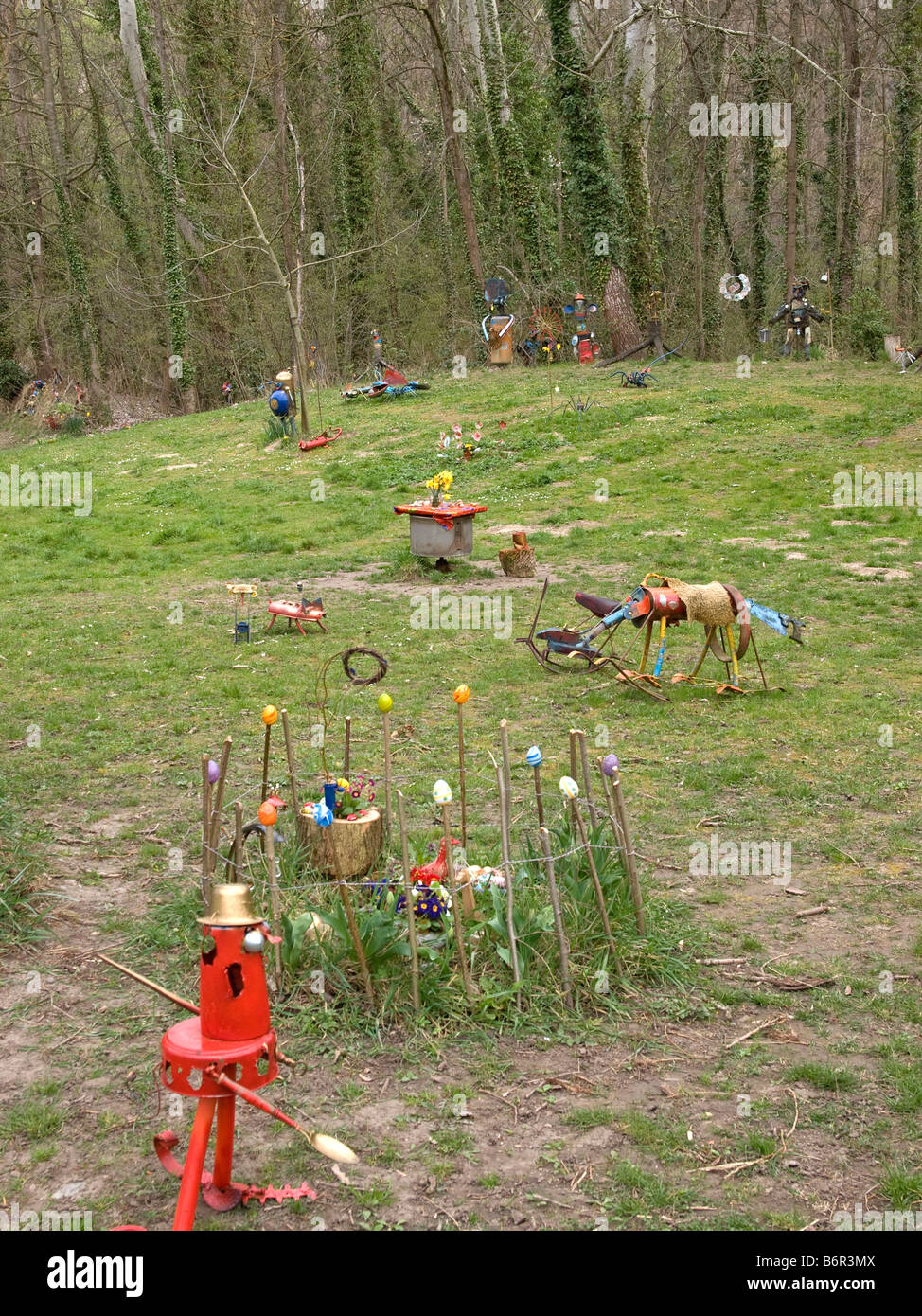art figures made of scrab old things in forest in Burkheim Baden Wuerttemberg Germany - Stock Image