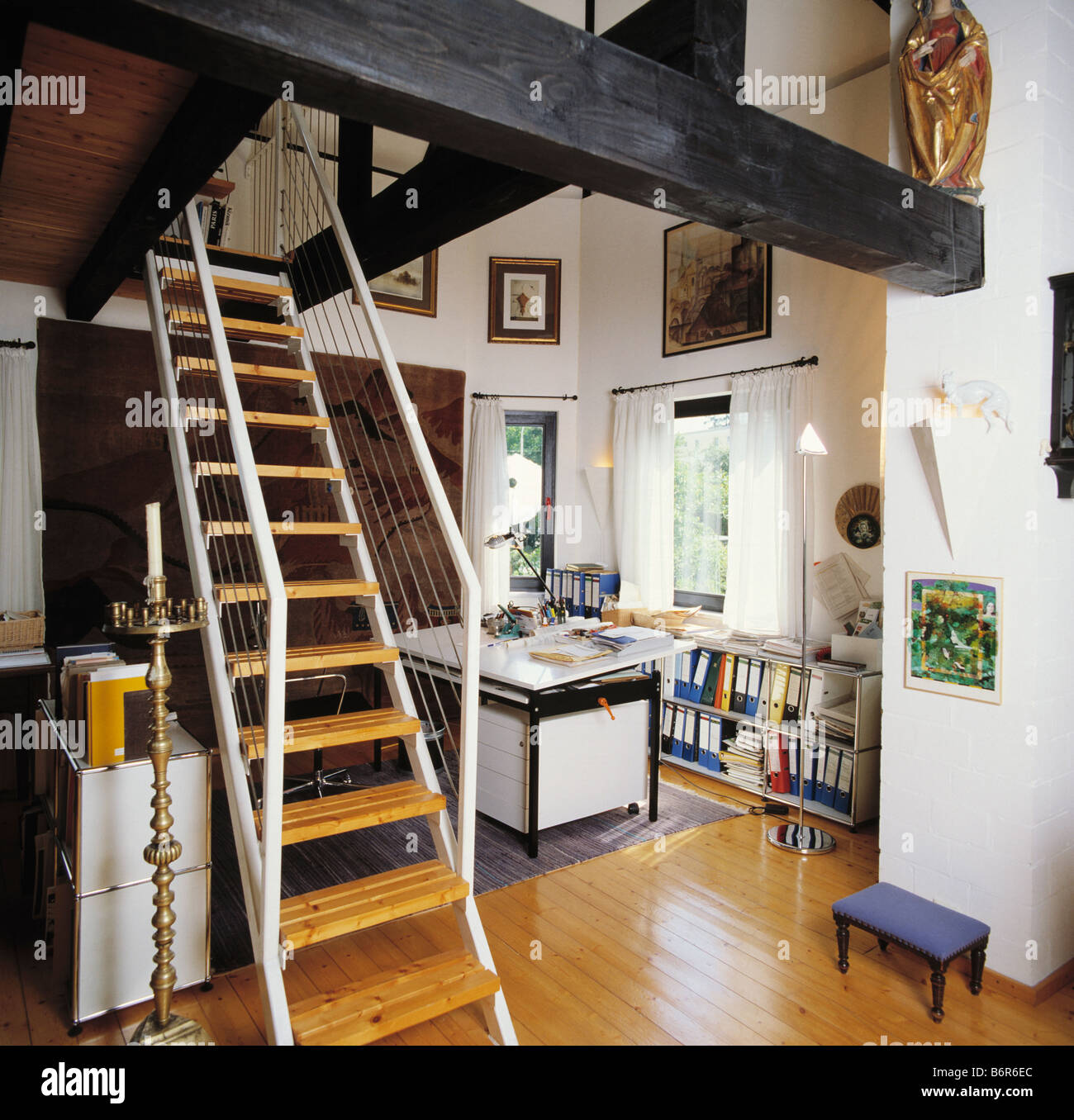 Ladder Staircase In Openplan Study With Large Black Ceiling Beams And  Wooden Flooring