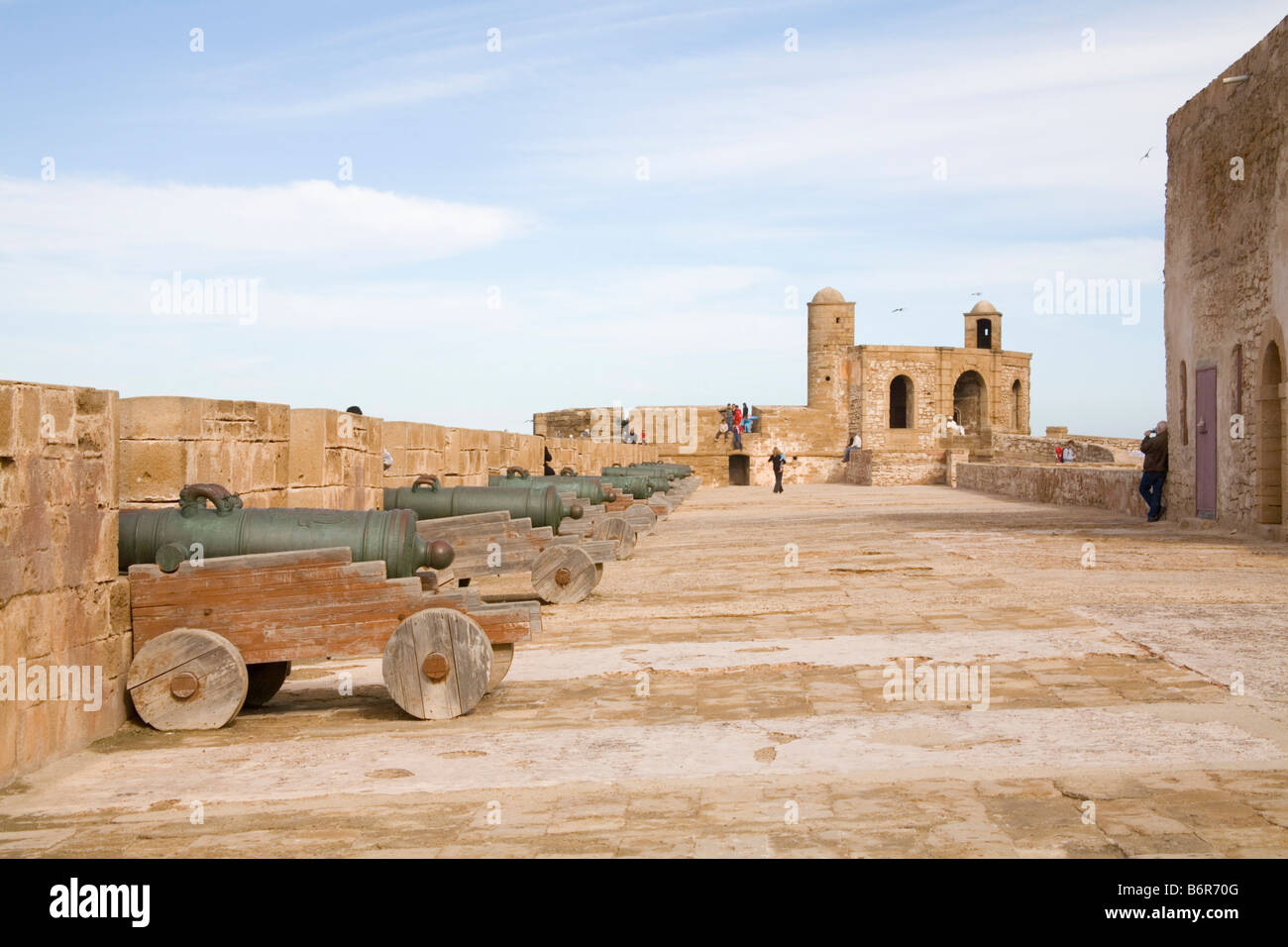 Essaouira Morocco North Africa December Looking along the old city ramparts with 17thc Spanish cannons - Stock Image