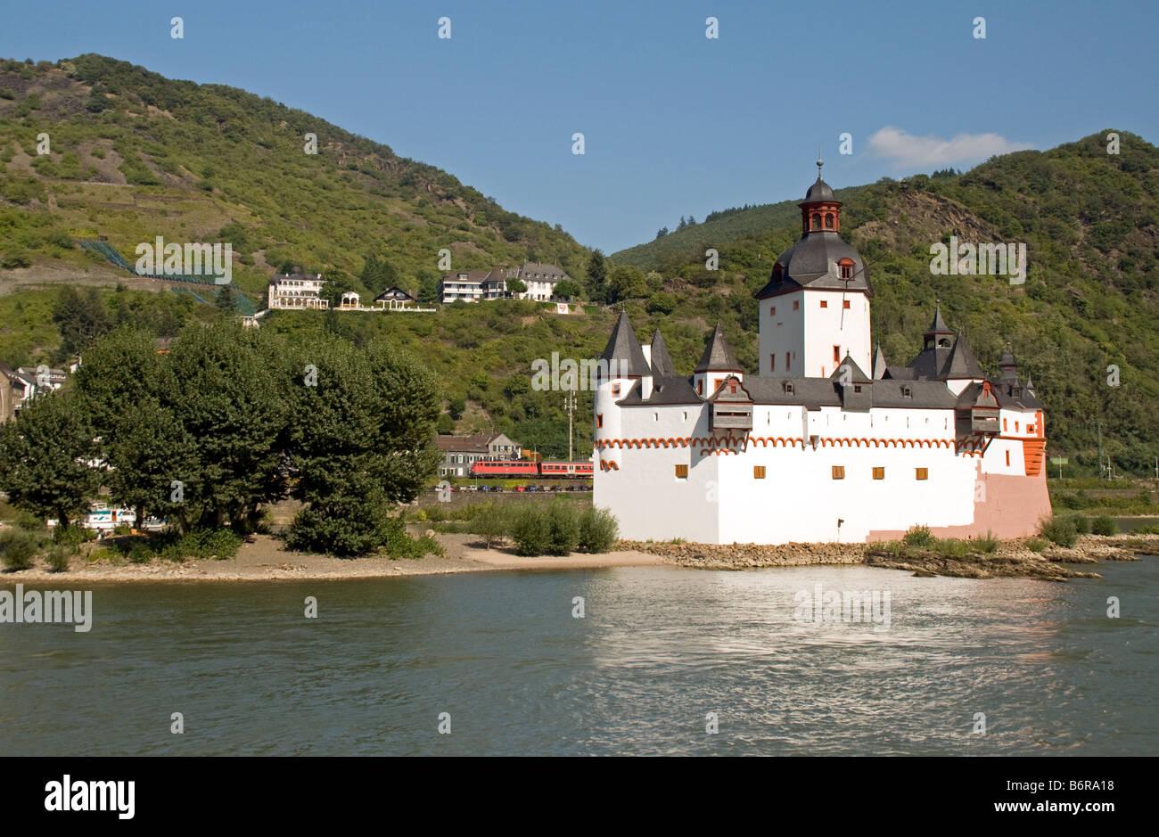 Pfalz Fortress on Rhine River at Kaub with intercity train in background Stock Photo
