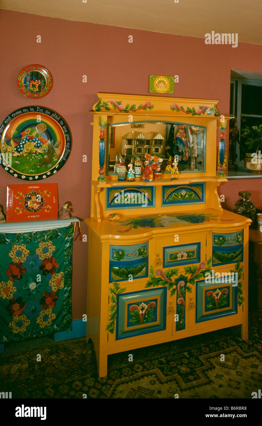 brightly painted furniture. Brightly Painted And Decorated Yellow Dresser In Sixties Dining Room - Stock Image Furniture A