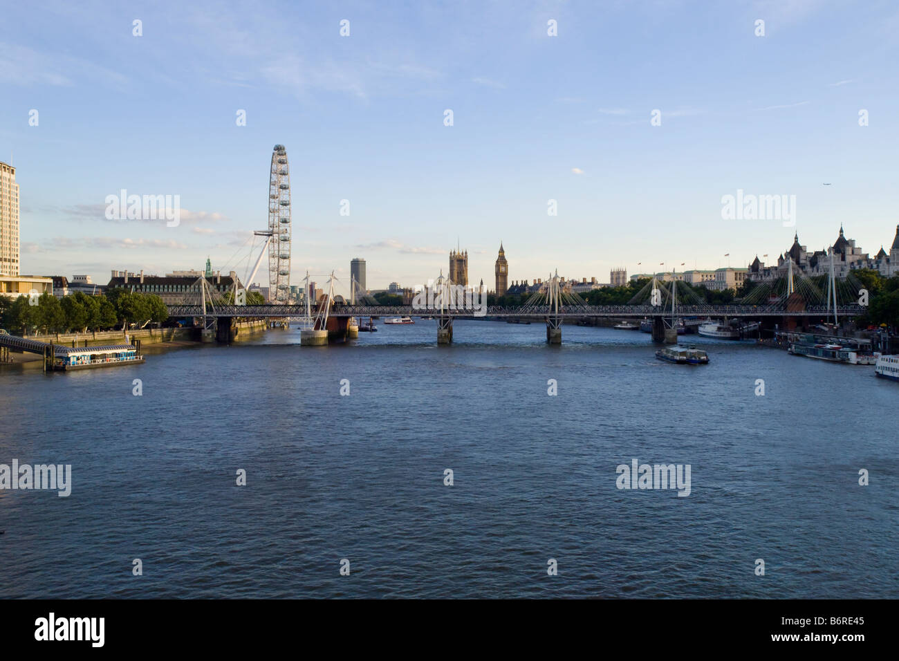 View of River Thames from Waterloo Bridge showing the Humber Bridge London Eye and Big Ben Stock Photo