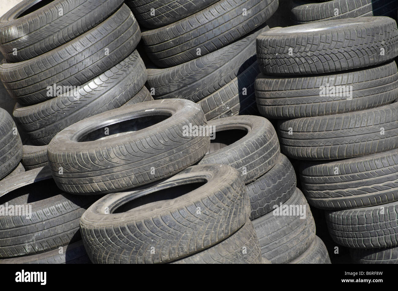 pile of used tyres - Stock Image