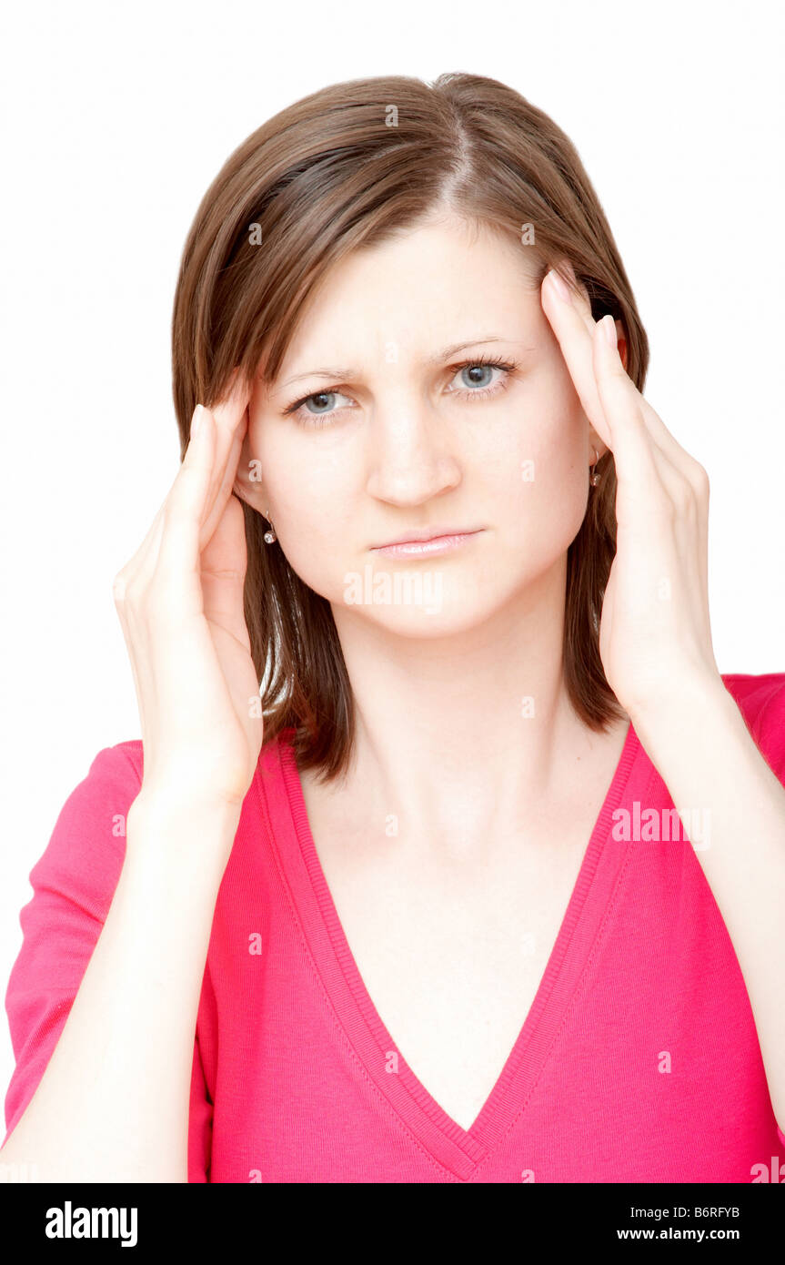 young woman touching her temples with both hands having a headache - Stock Image