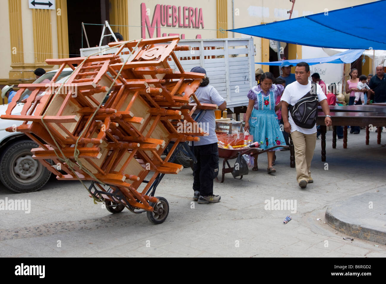 Tlacolula, Oaxaca, Mexico. Tlacolula Market. Man Moving Chairs on a Wheeled Dolly. - Stock Image