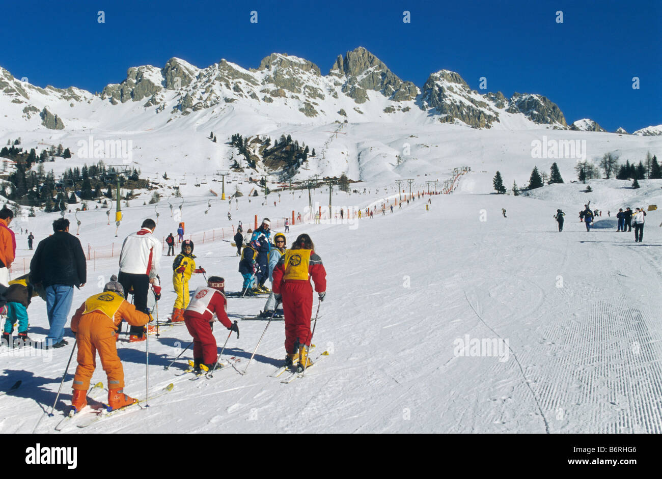 Skiing area at Passo di San Pelegrino in Marmolada mountain group in winter Dolomites Trentino Alto Adige region Stock Photo