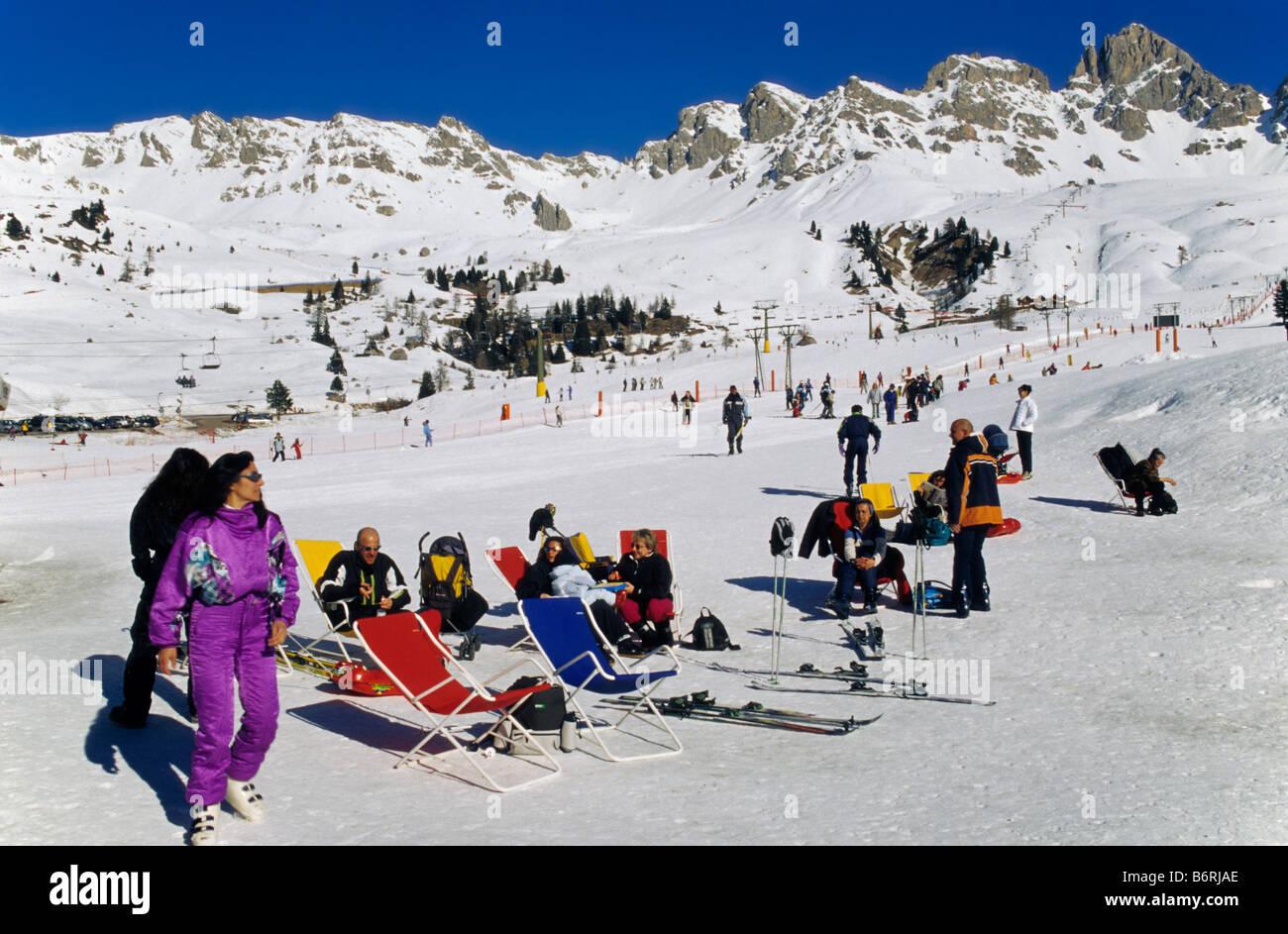 Skiers relaxing at skiing area at Passo di San Pelegrino in Marmolada mountain group Dolomites Trentino Alto Adige Stock Photo
