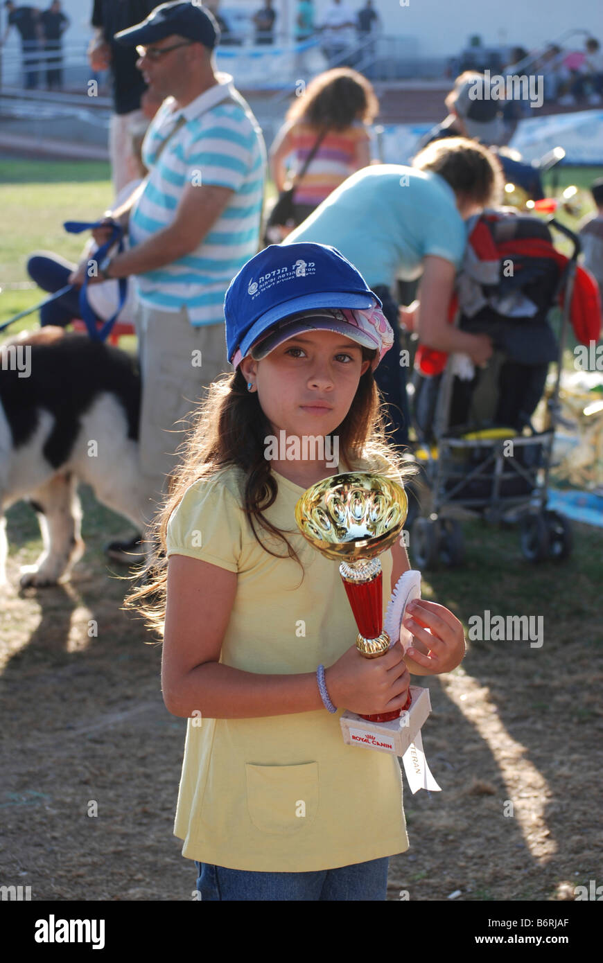 Israel International Dog Show May 17 2008 Young winner with her trophies - Stock Image