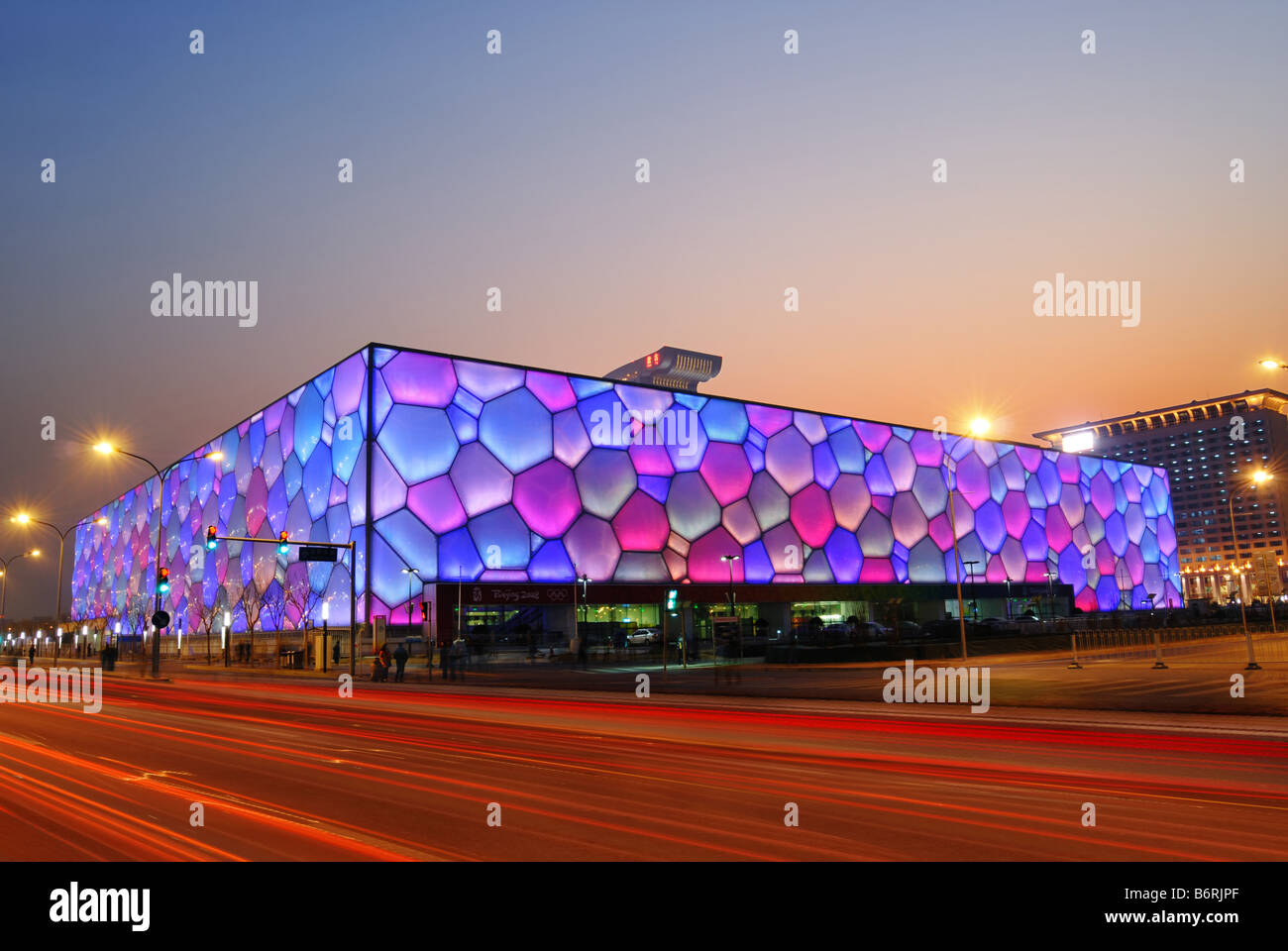 Beijing's swimming Olympic Stadium ('watercube') illuminated at dusk. - Stock Image