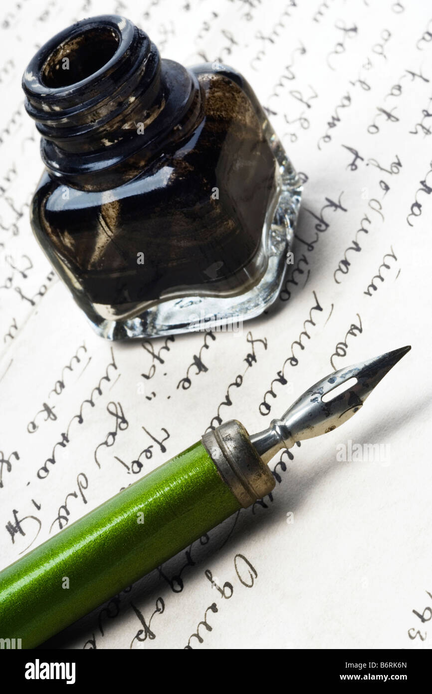 vintage writing tools nib and ink bottle on a letter - Stock Image