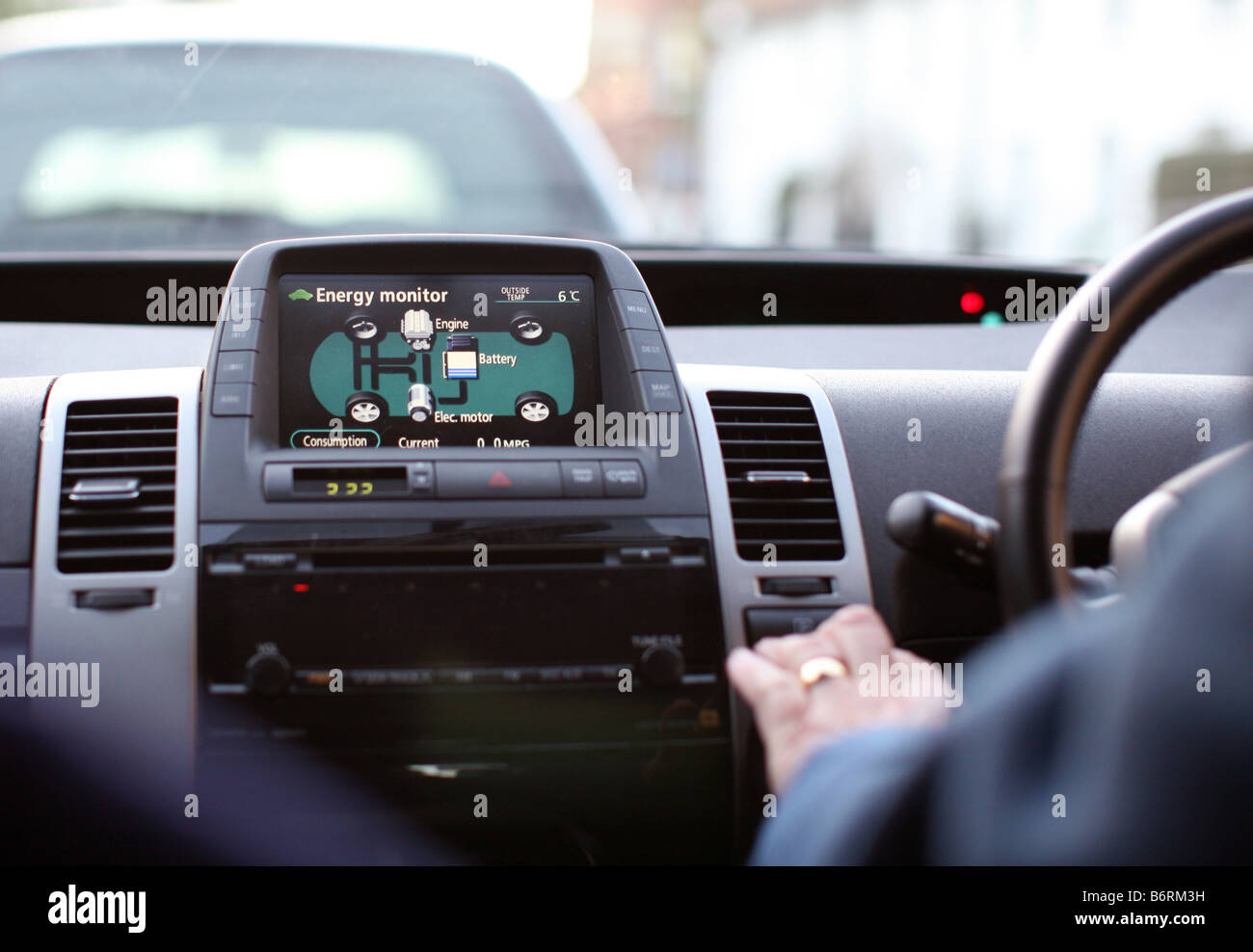 Energy monitor in Toyota Prius petrol electric hybrid car - Stock Image