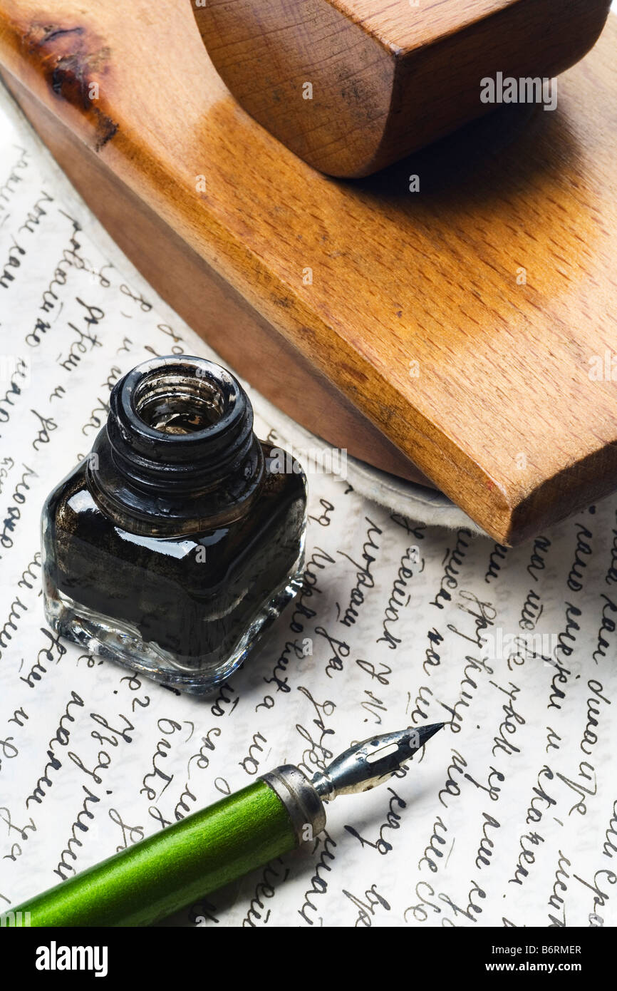 vintage writing tools nib ink bottle and an ink dryer on a letter - Stock Image