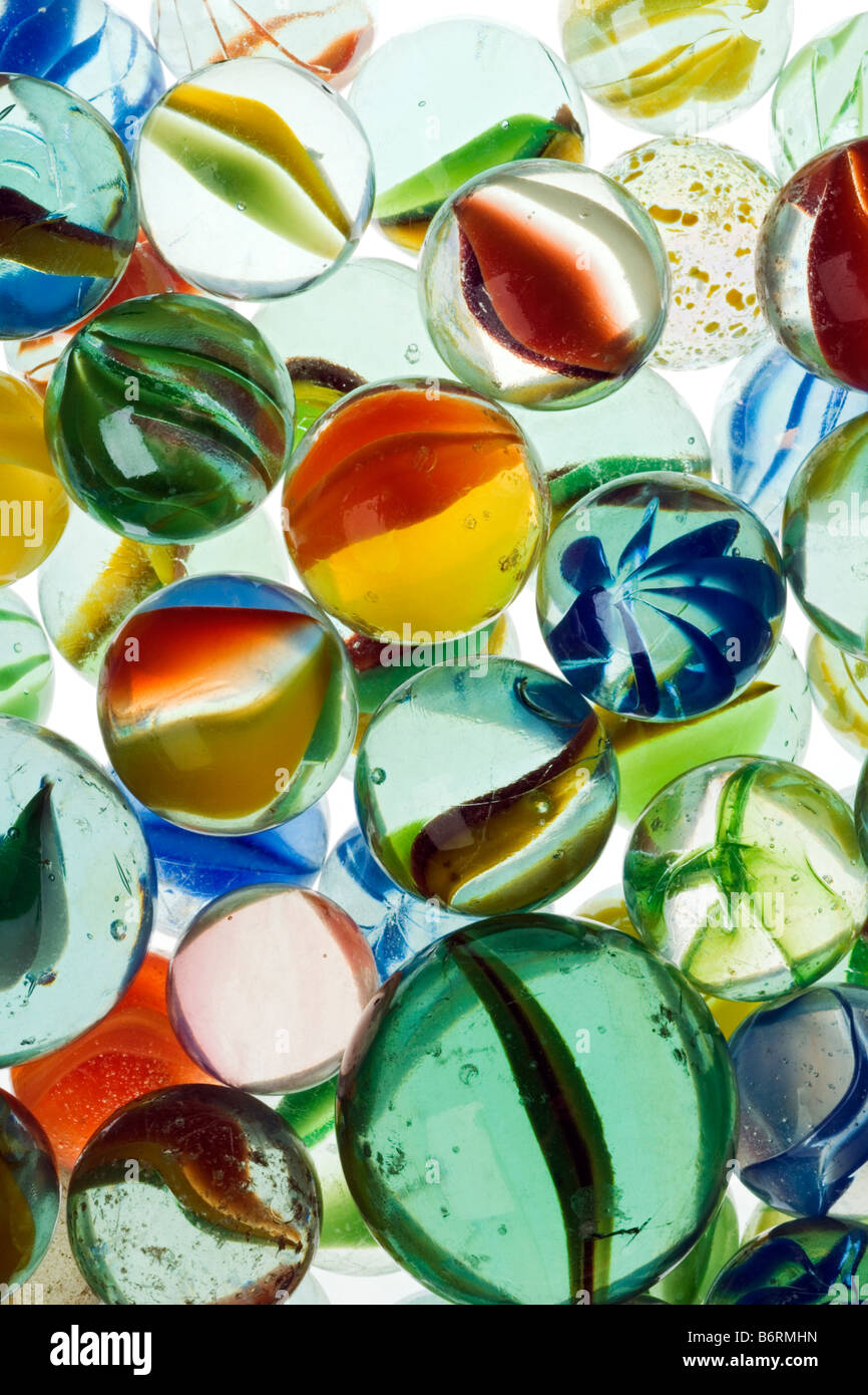 a lot of colorful marbles closeup - Stock Image