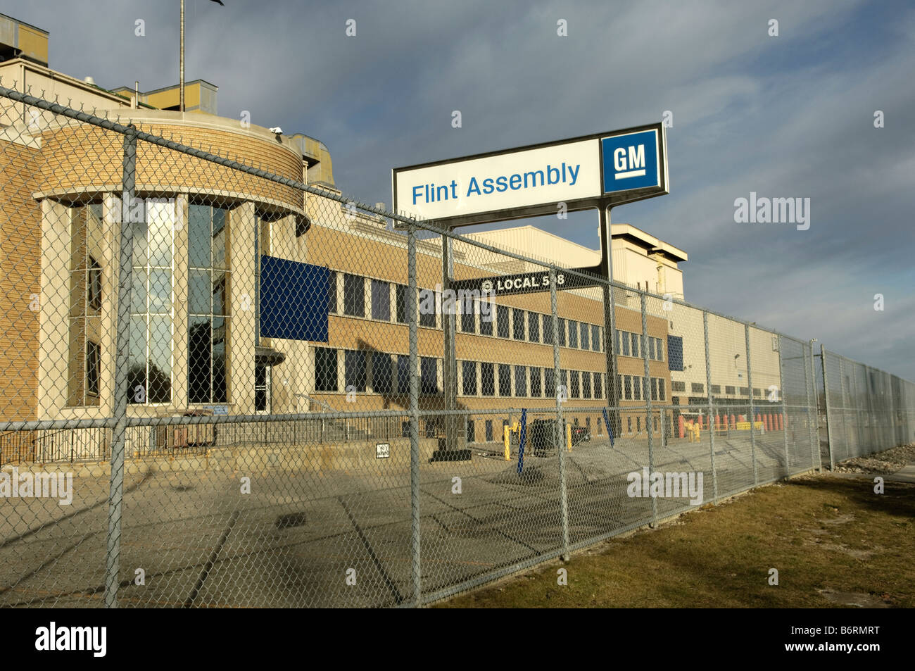 General Motors Flint Assembly factory building and sign in Flint Michigan USA. - Stock Image