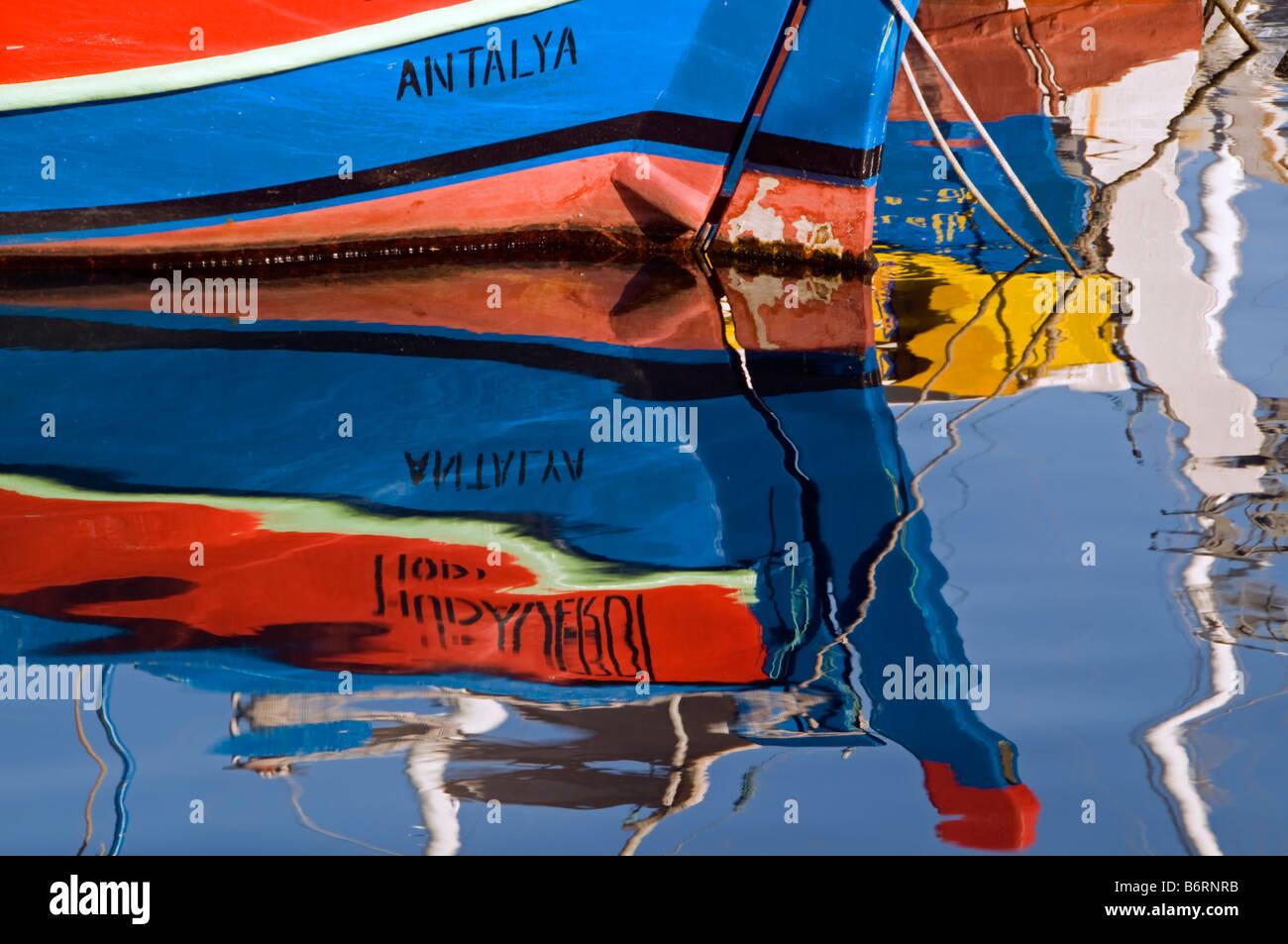 Reflection of fishing boat in Antalya Harbor - Stock Image