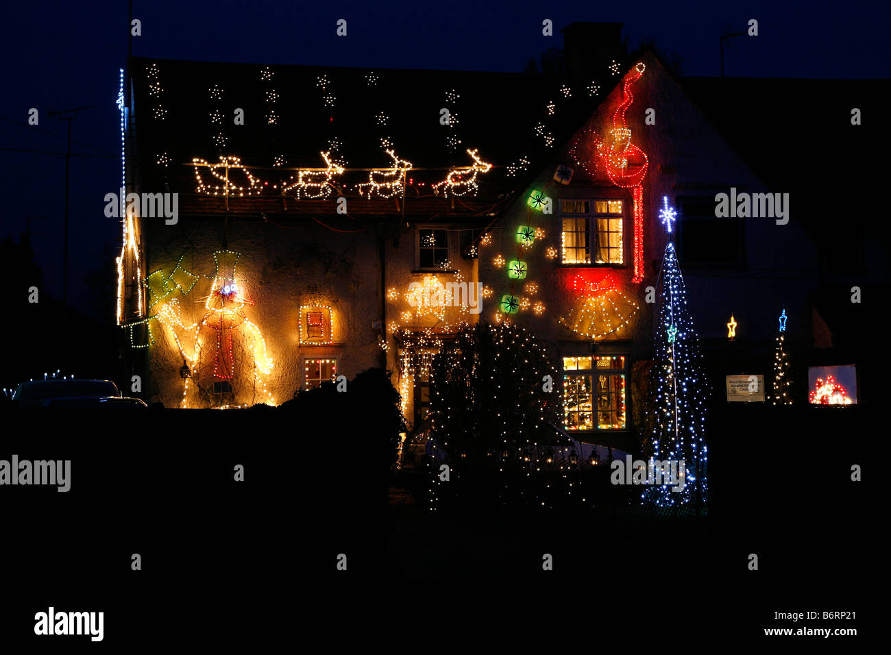 A house in South Heath, Buckinghamshire, England lit up with festive lights to celebrate the Christmas holiday - Stock Image