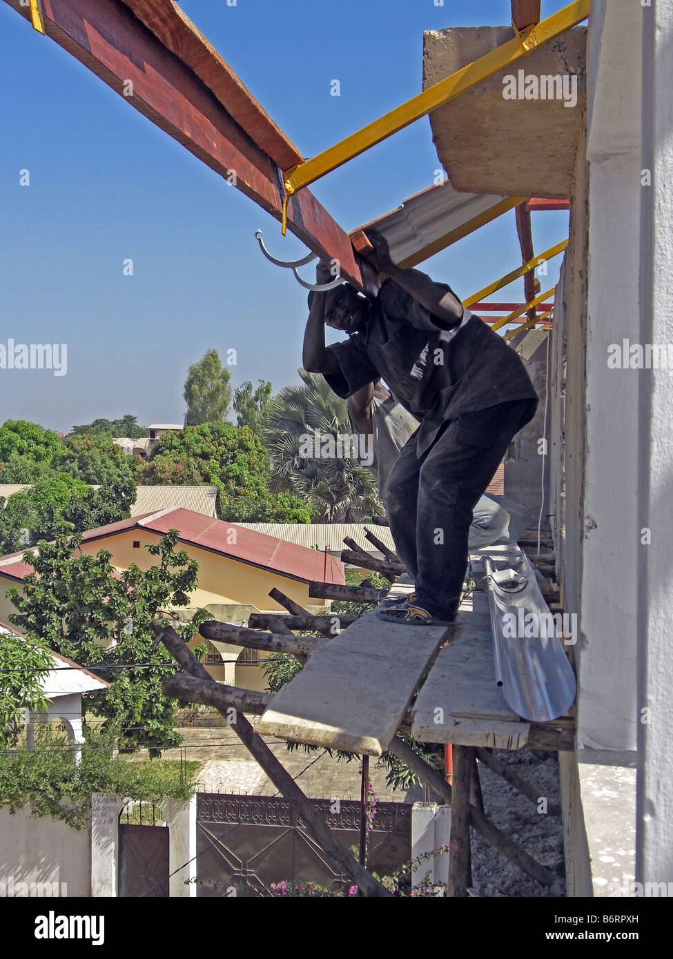 Unsafe Work Practice On A Building Site In The Gambia West