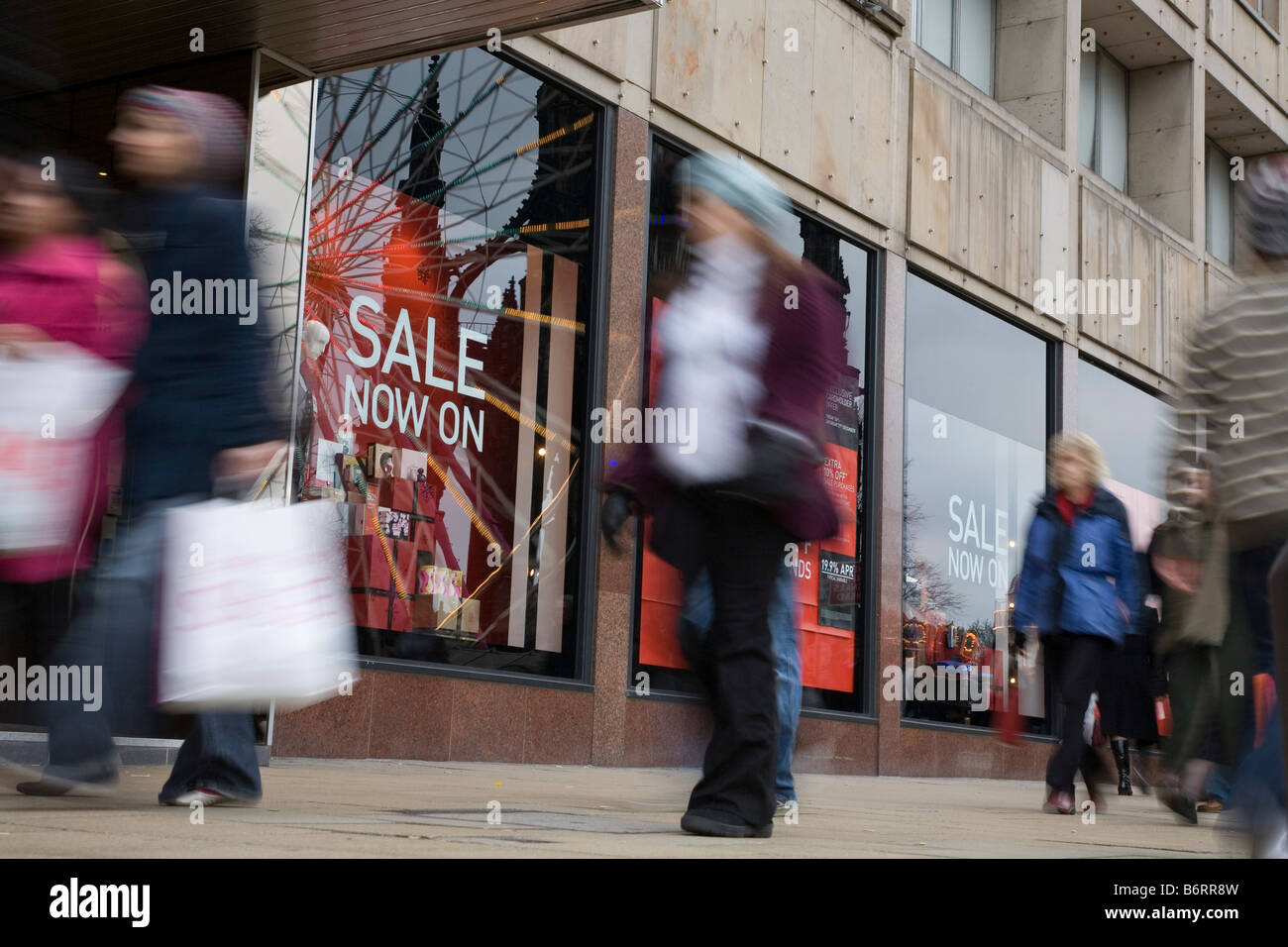 Shoppers in Princes Street, Edinburgh for the sales on Boxing Day - Stock Image