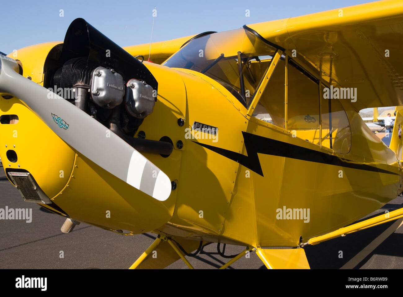 a Piper J3 Cub airplane on display at a fly in Stock Photo: 21423117