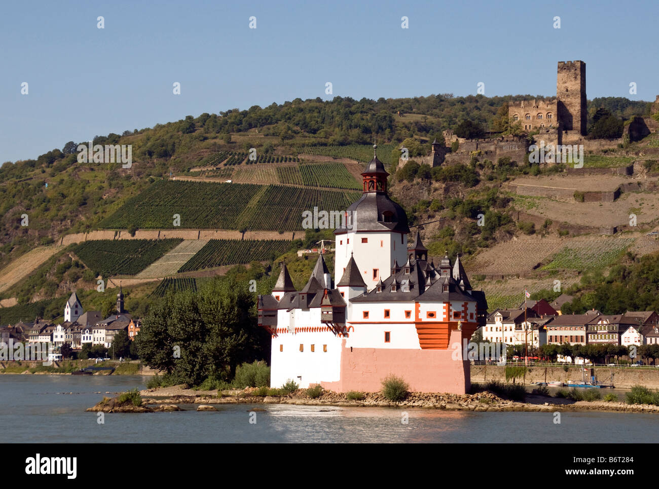 Pfalz Fortress on Rhine River at Kaub with vineyards and Gutenfels Castle in background Stock Photo