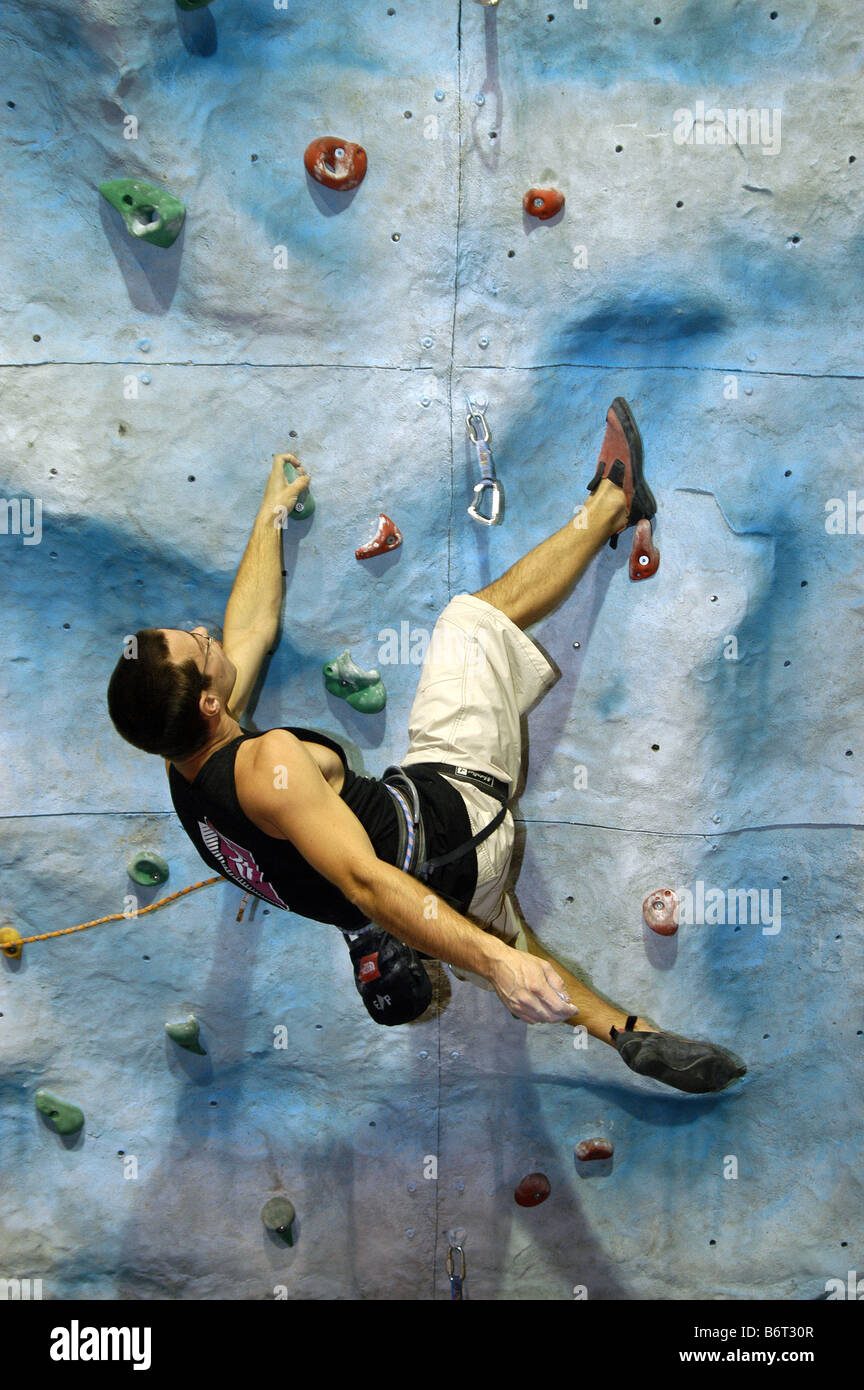 Climber Training on Artificial Indoor Climbing Wall - Stock Image