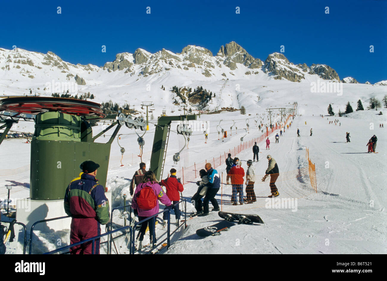 T-bar lift at skiing area at Passo di San Pelegrino in Marmolada mountain group in winter Dolomites Trentino Alto Stock Photo