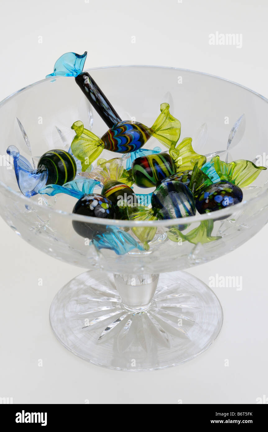 Murano blown glass candies in a Waterford crystal bowl on a white background - Stock Image