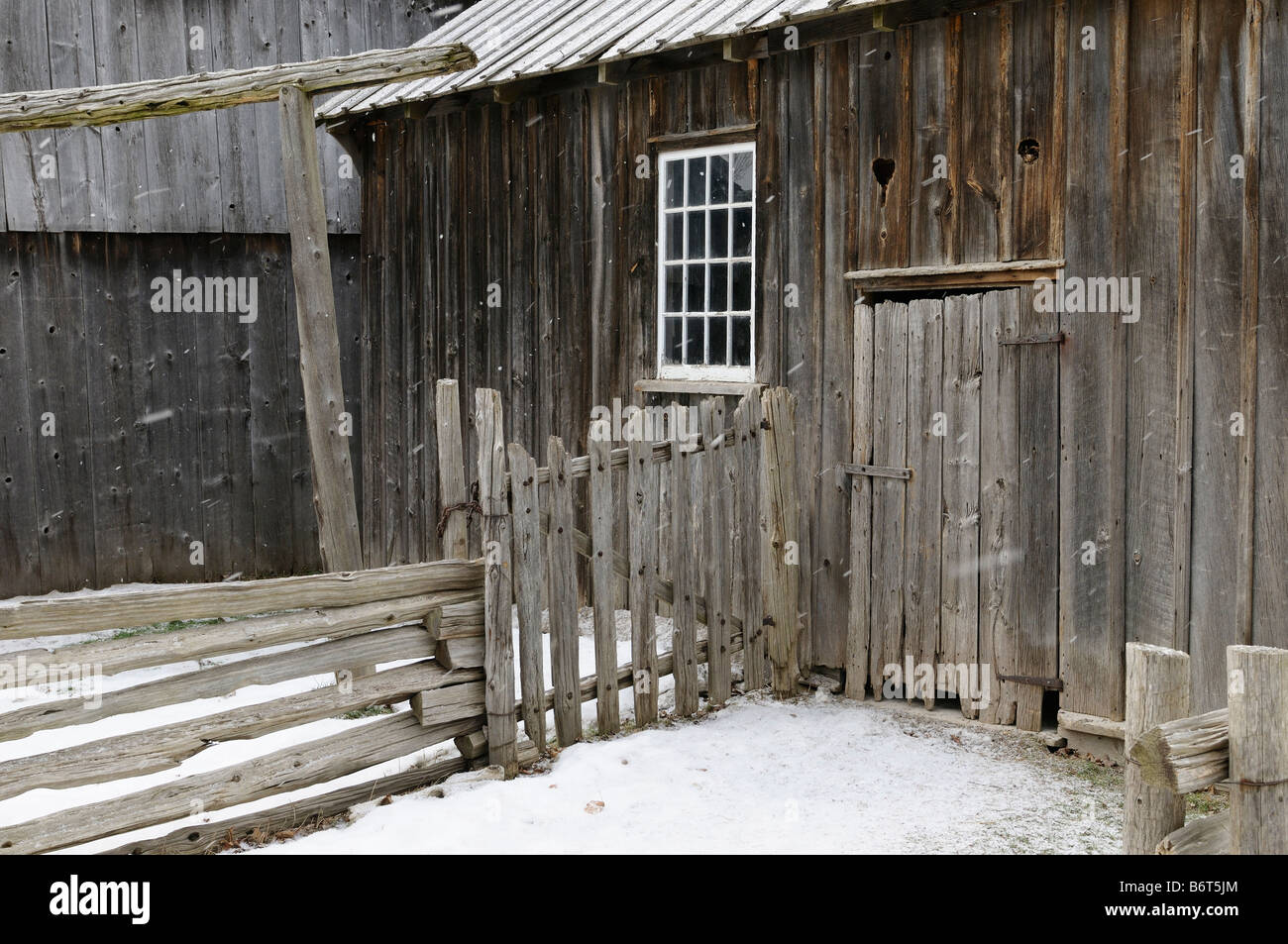 Outside of Edgeley slaughter house 1860 in winter snow at Black Creek Pioneer Village Toronto - Stock Image