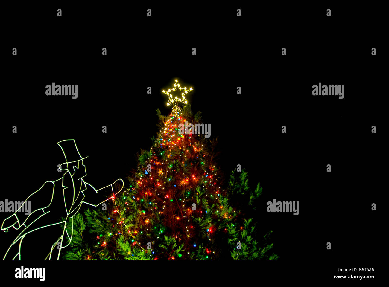 Christmas tree lights star at night figure in old fashioned clothes ...