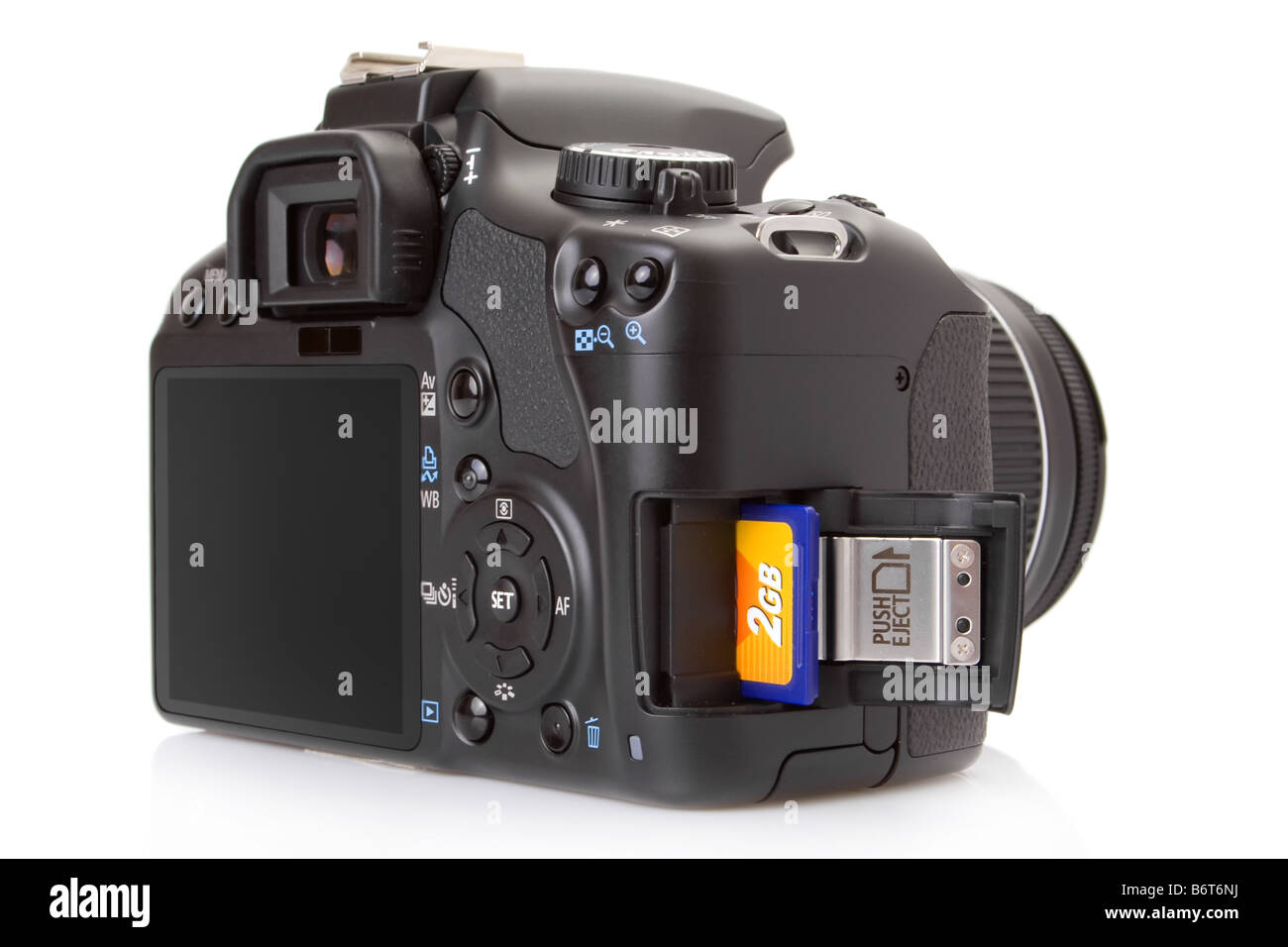 Digital slr with a SD (Secure Digital) memory card half inserted into slot - Stock Image