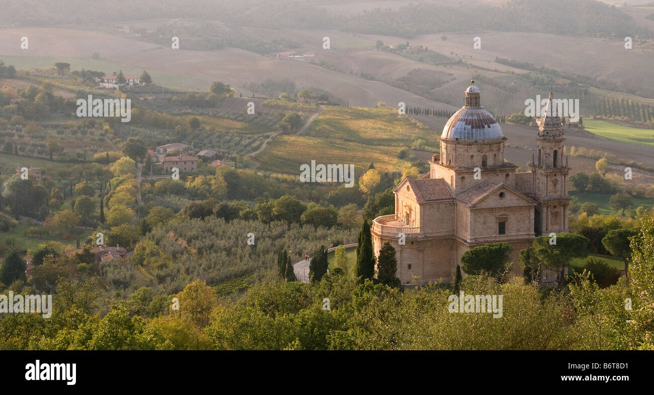 The Church of the Madonna di San Biagio in Tuscany Italy viewed from above o show the colourful blue dome and showing - Stock Image