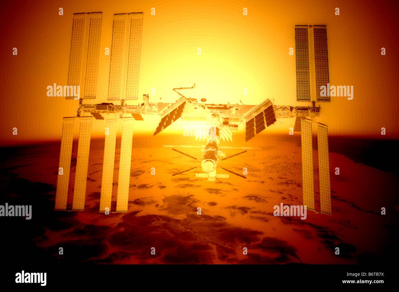 computer enhanced NASA image of International Space Station (ISS) flying above earth sunrise - Stock Image
