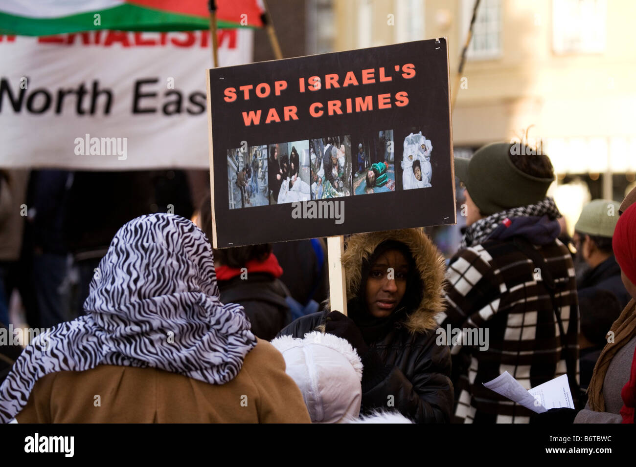 A placard at a demonstration in central Newcastle England says 'Stop Israel's War Crimes'. - Stock Image