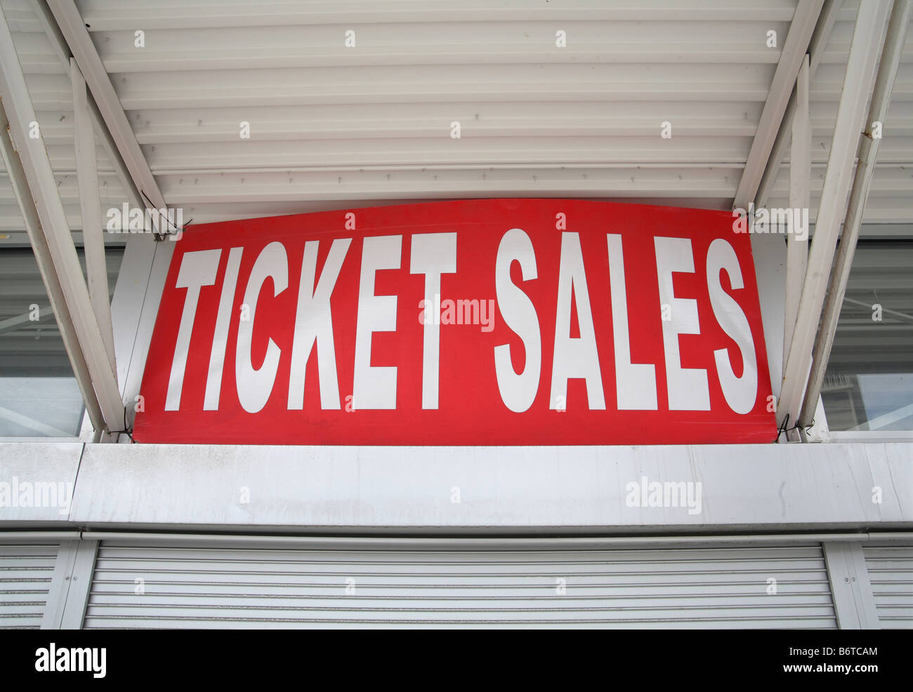 big red ticket sales sign above a booth window - Stock Image