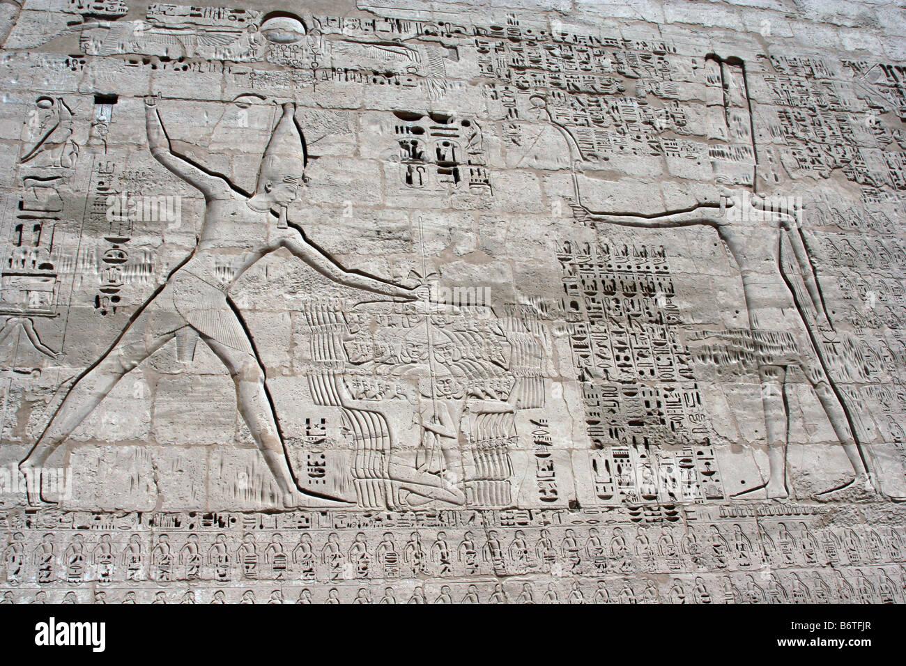 Relief of Rameses III smiting enemies, Mortuary Temple of Rameses III, Medinat Habu, Luxor, Egypt, c12th century - Stock Image
