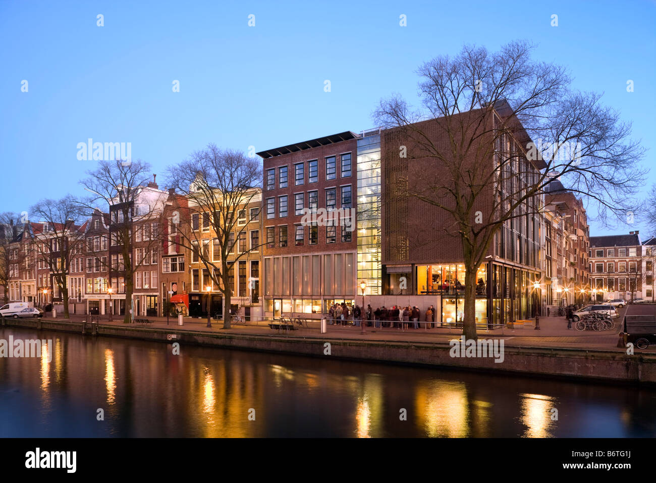Anne Frank Huis, House and Museum on the Prinsengracht Canal in Amsterdam, the Netherlands; Holland. At dusk in - Stock Image