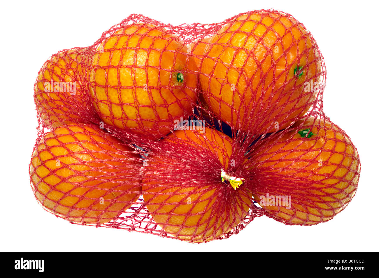 A pack of Clementines in a red mesh net bag - Stock Image