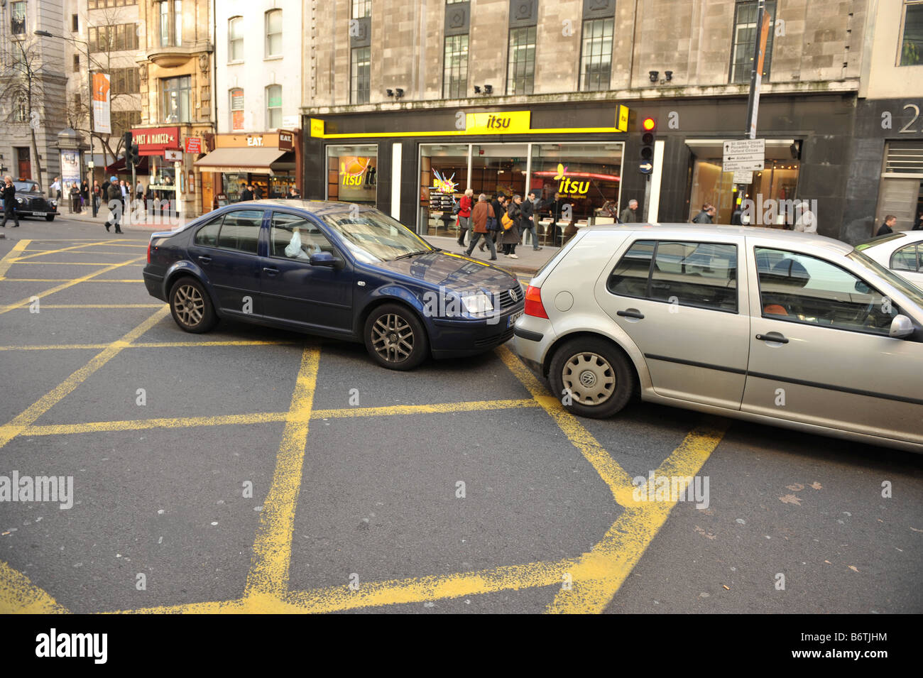 Cars stuck on the cross hatch grid at high hollborn london blocking the box - Stock Image