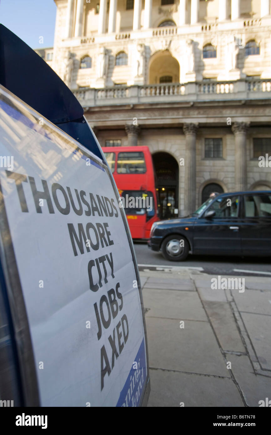 Paper Hoarding announcing more job losses infront of The Bank of England in London UK during the 2008 credit crunch - Stock Image
