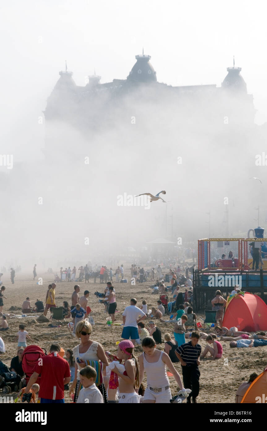 sea mist on scarborough beach yorkshire uk northern seaside town on sunny day atmospheric conditions weather busy - Stock Image