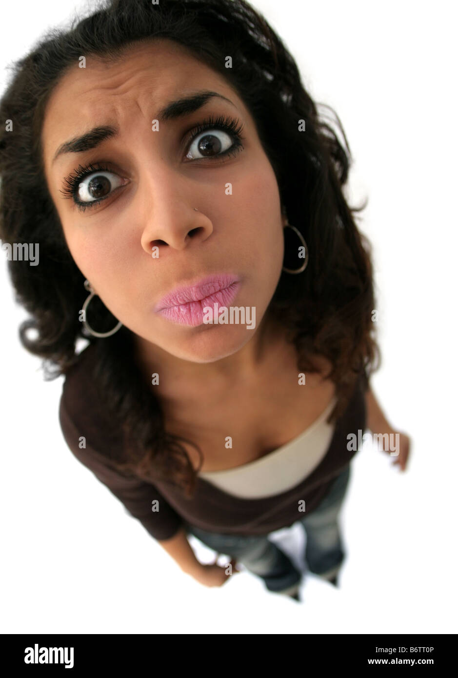 A teenage girl with a funny expression The picture was taken with fisheye lens Stock Photo