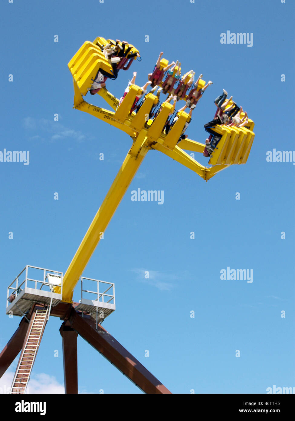 funfair ride fun fair amusement park thrill ride adrenaline rush scary scared silly stupid excitement - Stock Image