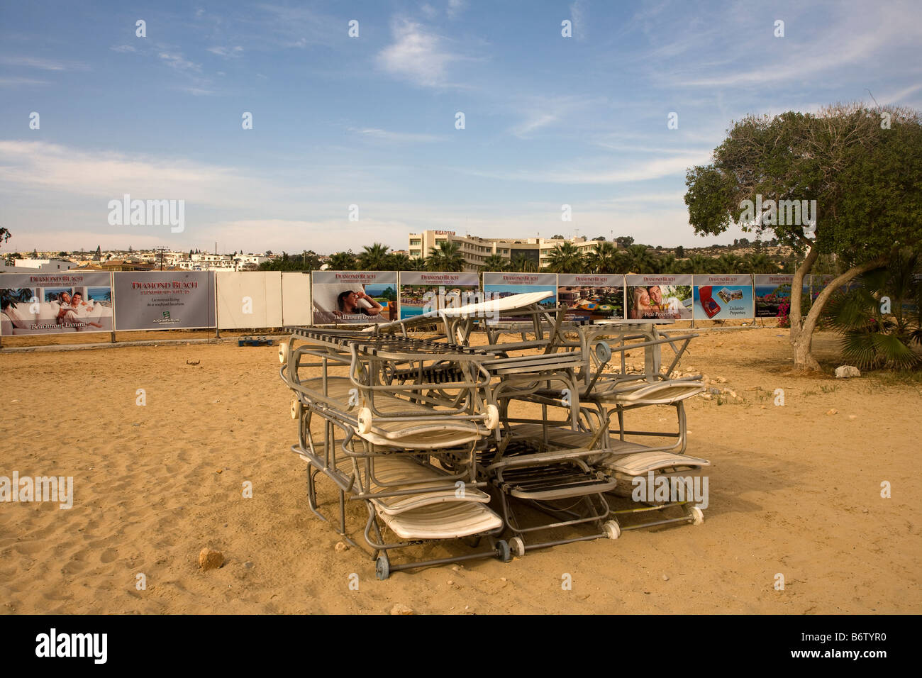 Stack of deckchairs on beach, Nicosia Green Line, Cyprus - Stock Image
