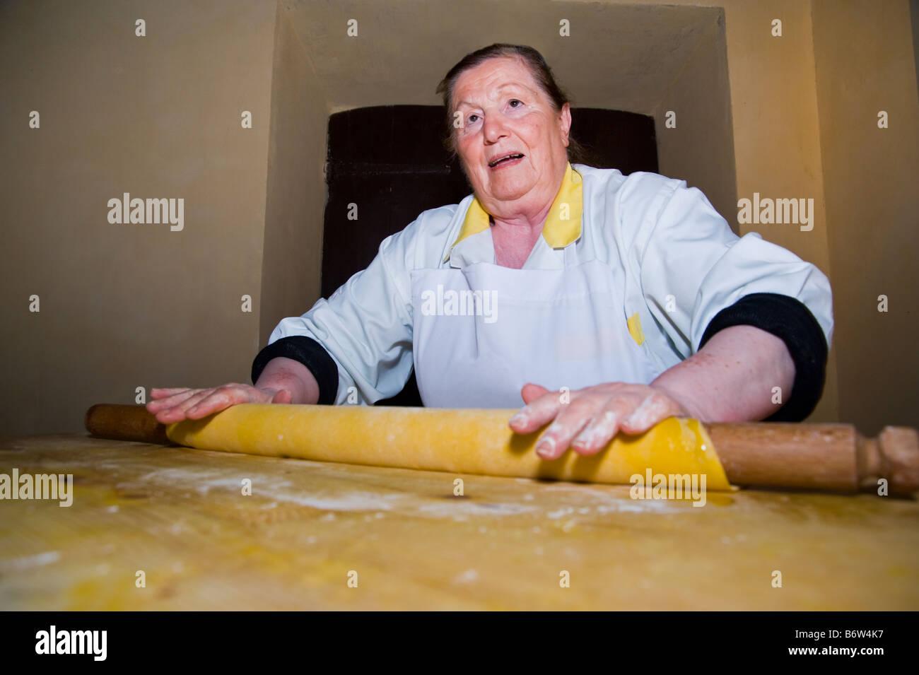 Woman preparing handmade pasta. - Stock Image