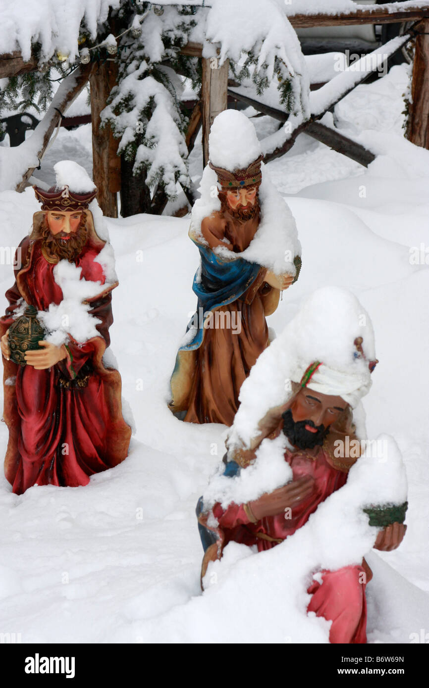 Three wise Men bearing gifts ,set in real snow ,part of the outdoor nativity scene in Montemonaco,Le Marche,Italy Stock Photo