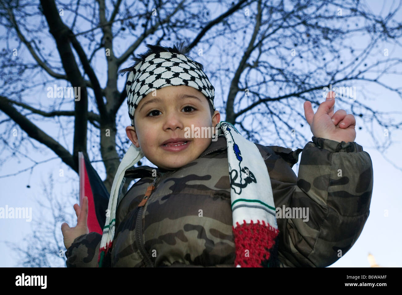 Little Palestinian Boy with Victory Sign at Anti-Israeli Demonstration in London after attacks on Gaza Strip. - Stock Image